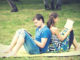 couple reading in a park in the summer